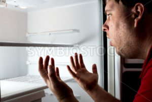 Man trying to find his next meal. It's gone - Stock Images 4 You