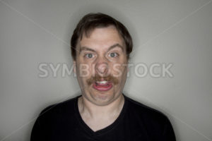 Man with a mustache making a funny face. - Stock Images 4 You