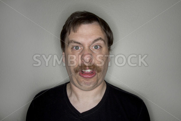 Man with a mustache making a funny face. – Stock Images 4 You