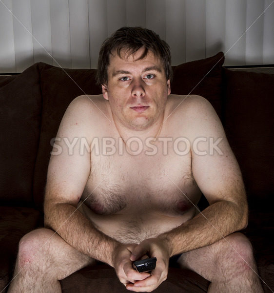 Obese naked man watching TV – Stock Images 4 You