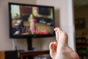 Relaxing watching some TV - Stock Images 4 You