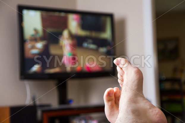 Relaxing watching some TV – Stock Images 4 You