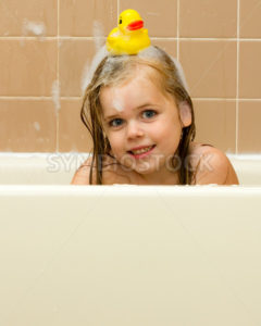 Rubber ducky on her head - Stock Images 4 You