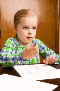 She is looking up from her masterpiece - Stock Images 4 You