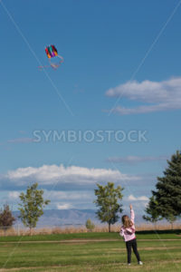 Young girl flying a kite - Stock Images 4 You