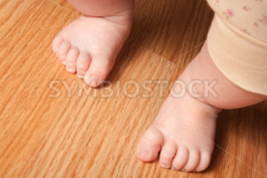 Young girl taking her first steps - Stock Images 4 You