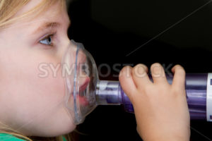 Young girl with breathing problems - Stock Images 4 You