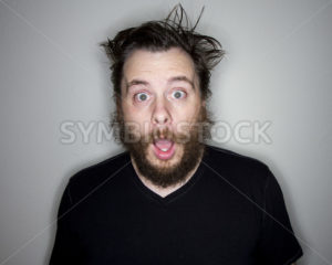 bearded man looking at the camera shocked - Stock Images 4 You
