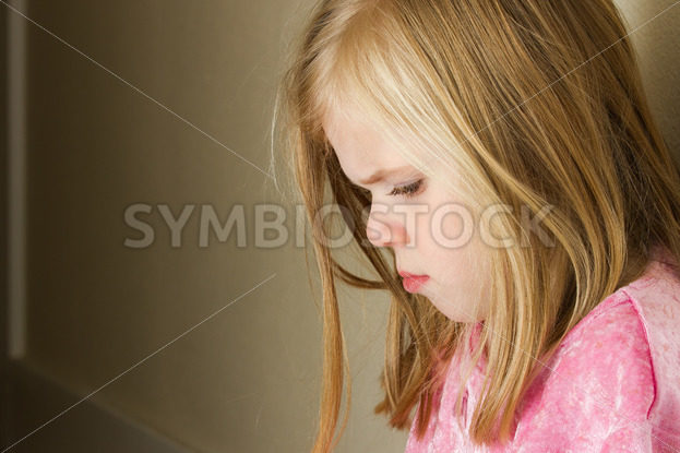 child against the wall with a sad look – Stock Images 4 You