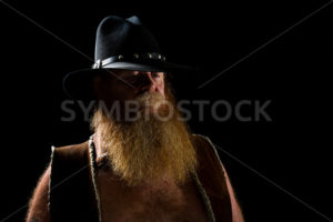 cowboy wearing a leather vest - Stock Images 4 You