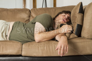 fat guy passed out hard on the couch - Stock Images 4 You