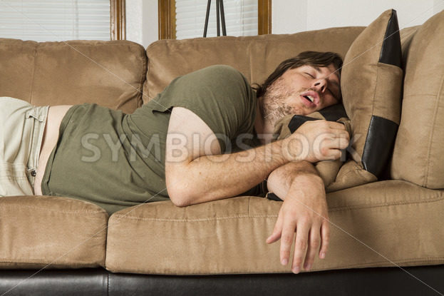 fat guy passed out hard on the couch – Stock Images 4 You