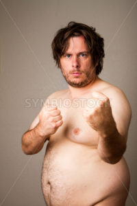 fat man wants to fight - Stock Images 4 You