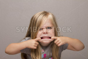 girl making funny faces to the camera - Stock Images 4 You