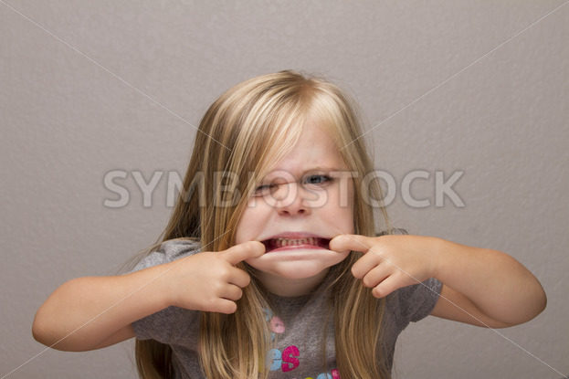 girl making funny faces to the camera – Stock Images 4 You