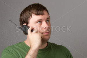 man waiting on his phone. - Stock Images 4 You